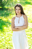 Portrait of beautiful girl in green field — Stock Photo