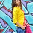 Young beautiful stylish girl with bag — Stok fotoğraf