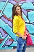 Young beautiful stylish girl with bag — Stock Photo