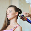 Young beautiful woman making hairstyle by stylist artist — Stock Photo