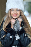 Young smiling girl winter portrait — Stock Photo