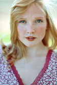 Face of a beautiful girl with freckles closeup — Stock Photo