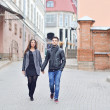 Young couple walking in an old town  — Stock Photo