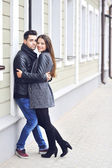 Young cheerful couple - outdoor portrait — Stock Photo