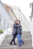 Young handsome couple having fun in an old town — Stock Photo