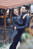 Young smiling couple - outdoor portrait — Stock Photo