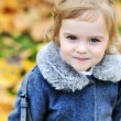 Cute little girl in autumn park  — Stock Photo