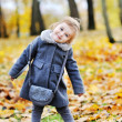 Cute little girl portrait in autumn park  — Stock Photo