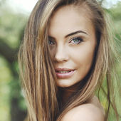 Close up of a beautiful girl face - outdoor portrait — Stock Photo