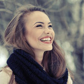 Young beautiful laughing girl in winter - close up — Stock Photo