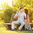 Couple hugging in a park - soft warm colors — Stockfoto