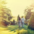 Young beautiful couple walking in a summer park — Stock fotografie