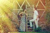 Outdoor portrait of young sensual couple in summer — Stock Photo