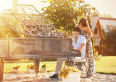 Young beautiful couple playing on a piano in a park — Stock Photo