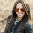 Attractive young woman in sunglasses - closeup — Stock Photo