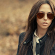 Closeup of a beautiful fashion woman in sunglasses  — Stock Photo