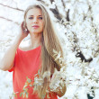 Portrait of a beautiful girl in blooming spring tree — Stock Photo