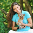 Young beautiful girl with her puppy outdoor — Stockfoto