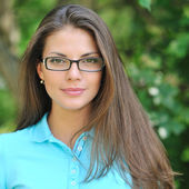 Young beautiful woman wearing glasses - closeup — Stockfoto