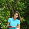 Stock Photo: Girl with book in park