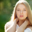 Portrait of beautiful young blond woman with clean face - outdoo — Stock Photo