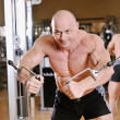 Stock Photo: Bodybuilder posing at gym