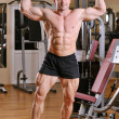 Bodybuilder posing at gym — Stock Photo