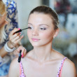 Applying make up — Stock Photo