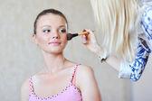Applying make-up — Stock Photo