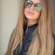 Stock Photo: Beautiful girl in sunglasses