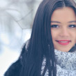 Beauty girl on the winter background — Stock Photo