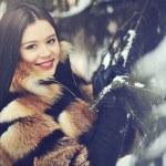 Beautiful woman in winter wood - closeup — Stock Photo #36429583