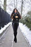 Beautiful brunette girl in winter clothes — Stock Photo