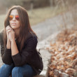 Young beautiful lady in sunglasses at sunny day - outdoors portr — Stock Photo