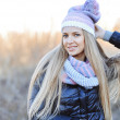 Beautiful happy girl in gray sweater and scarf — Stock Photo