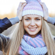 Fashionable young woman wearing hat and scarf — Stock Photo