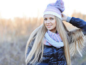 Beautiful happy girl in gray sweater and scarf — Stok fotoğraf