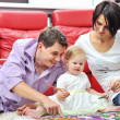 Happy family drawing and painting at home together — Stock Photo