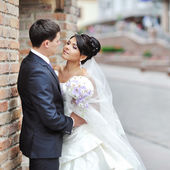 Bride and groom in an old town - wedding couple — Stock Photo