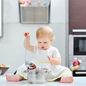 Sweet little girl cooking on a kitchen — Stock Photo