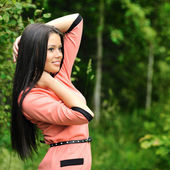 Portrait of young beautiful woman posing outdoors — Stock Photo