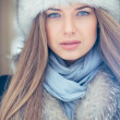 Portrait of blond young woman in winter — Stok fotoğraf