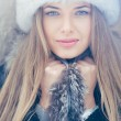 Beautiful winter portrait of young woman in the winter — Stock Photo