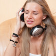 Young beautiful woman listening to music with headphones — Stock Photo #36737143