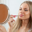 Woman applying make up. Lipgloss. Lipstick — Stock Photo
