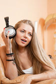 Young beautiful woman enjoying the music at home — Stock Photo