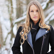 Portrait of blond young woman in winter — Stockfoto