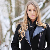 Portrait of blond young woman in winter — Stock Photo