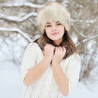 Snow winter woman portrait outdoors. Snowy white winter day — Stock Photo #37082741