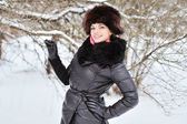 Smiling beautiful young woman. Outdoor in a winter day — Stok fotoğraf